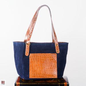Bolso de ante azul con bolsillo print de cocodrilo